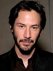 Keanu Reeves's Car Hits Photographer