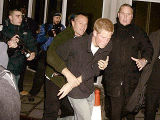 Prince Harry Tussles with Photographer