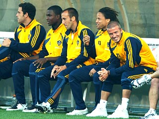 David Beckham Watches Team from Sidelines