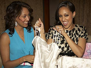 Tia Mowry (right) with sister Tamera Mowry at her March 14 bridal