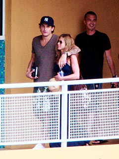 Jennifer Aniston and John Mayer Get Cozy Poolside