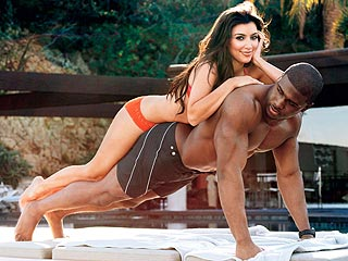 Kim Kardashian Gets Horizontal with Reggie Bush