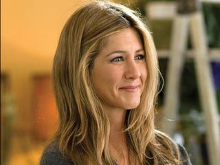 Jen Aniston Grins and Bags It on The Bounty Set