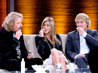 Jennifer Aniston and Owen Wilson Chow on Dog Treats