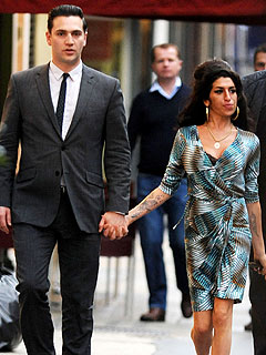 Amy Winehouse Steps Out with Dapper New Beau