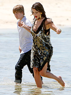Kim Kardashian and Justin Bieber Walk Hand-in-Hand on the Beach