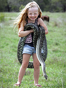 3-Year-Old Befriends Snake Four Times her Size