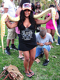 Spotted: 'Jersey Shore' Star Snooki Charms a Snake