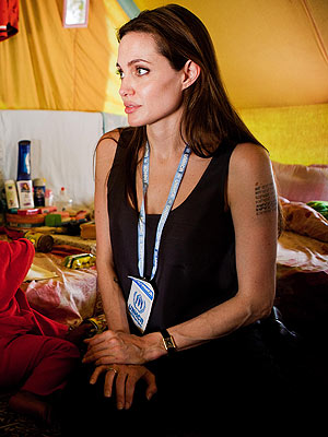 Angelina Jolie's New Tattoo: Does It Mean She's Adopting Again?