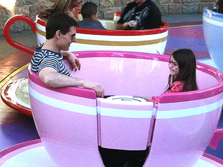 Tom Cruise & Suri Ride the Tea Cups at Disneyland