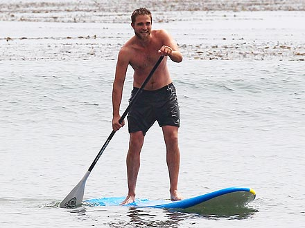 Robert Pattinson Paddle Boards in Malibu – Shirtless!