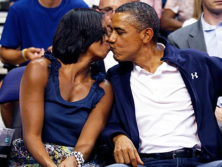 President Barack Obama, First Lady Michelle Obama Kiss at Team USA Game