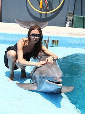Victoria Beckham Smiles with a Dolphin