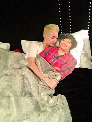 Miley Cyrus Tweets Photo in Bed with Cardboard Harry Styles