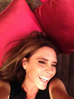Victoria Beckham Smiling in Photo on David Beckham's Facebook Page