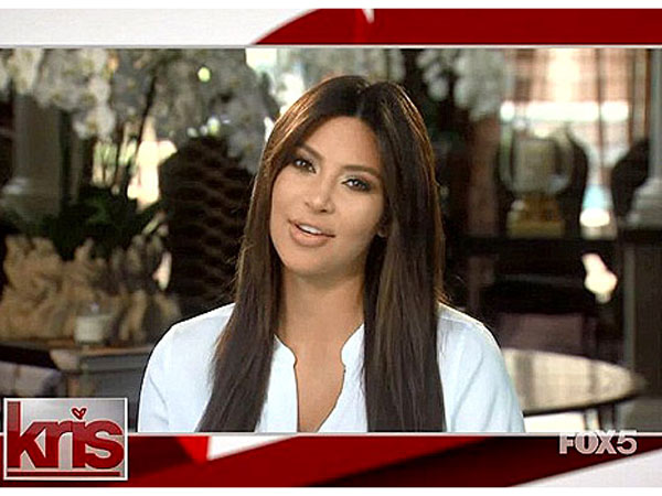 Kim Kardashian Appears via Video to Say She's 'Loving Life at Home'