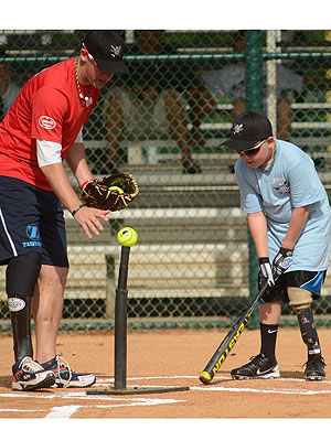 The Wounded Warrior Amputee Softball Team Helps Young Amputees