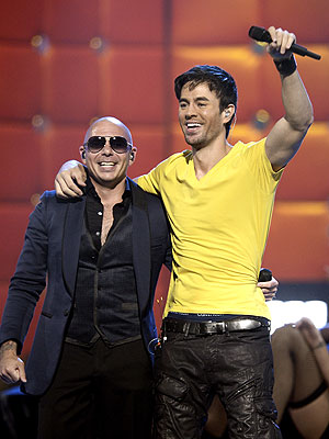 Pitbull, Marc Anthony Stand Out at Rain-Drenched Latin Grammys