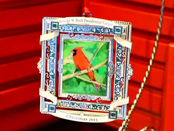 George W. Bush Selling Christmas Ornament with Cardinal Painting