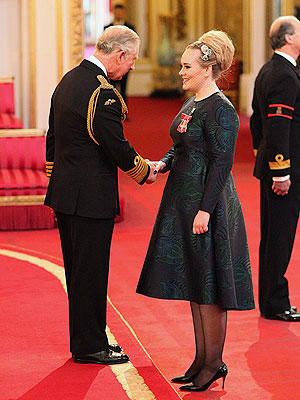 Adele Receives MBE Medal from Prince Charles