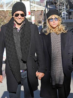 PHOTO: Bradley Cooper and Suki Waterhouse Get Cozy at Sundance