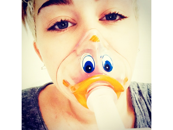 Miley Cyrus Postpones Bangerz Tour, Wears Duck-Face Oxygen Mask