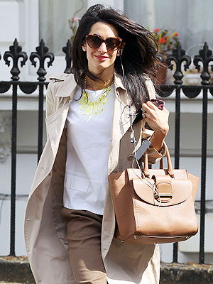 PHOTO: Amal Alamuddin Shows Off Engagement Ring En Route to Work