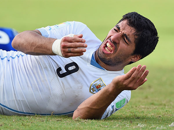 Luis Suárez: World Cup Bad Boy Bares His Teeth