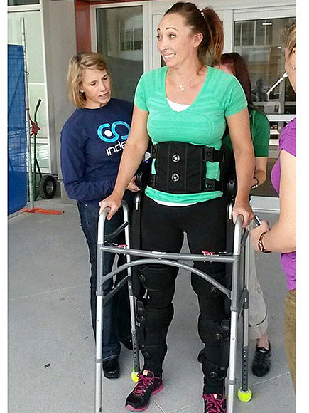 Olympic Swimmer Amy Van Dyken Walking with Use of Special Equipment