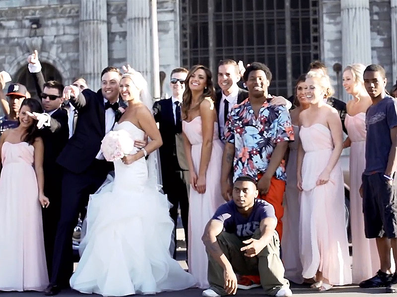 Couple Behind #westillcoming Wedding Photo Share the Real Rap Video Story