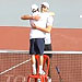 "5'9"" Tennis Player Uses Chair to Help Hug 6'11"" Opponent Post-Match (VIDEO)"