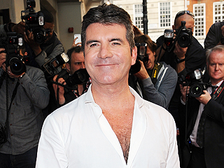 Simon Cowell: 'I Still Haven't Changed' My Son's Diaper