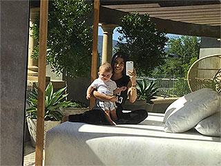 Kourtney Kardashian Gets 'Serious' in a Rare Photo with Baby Reign