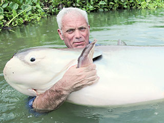 River Monsters: Watch Jeremy Wade Get Way Too Close to a Killer Crocodile