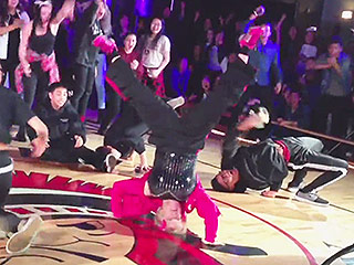 60-Year-Old Dance Teacher Surprises Students with Insane 'Uptown Funk' Performance