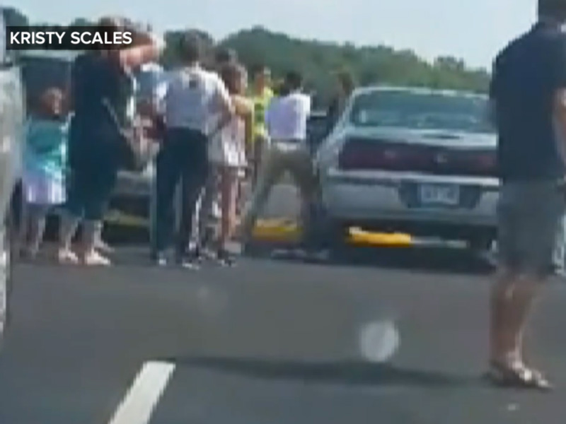 Woman Smashes Window to Free Toddler Trapped in Hot Car