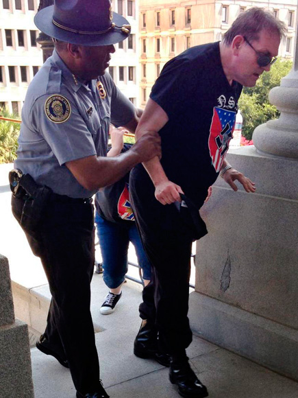 Black Police Official Helps White Supremacist Suffering from Heat Exhaustion