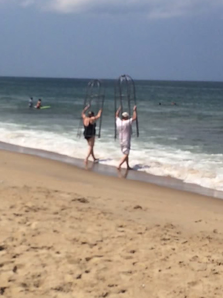 Couple Wear Personal 'Shark Cages' at North Carolina Beach
