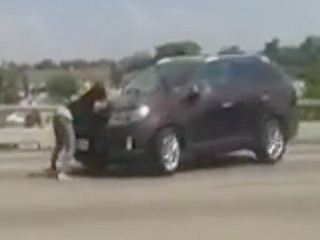 VIDEO: Pregnant Woman Clings to Car's Windshield for a Mile in Fight with Ex-Boyfriend over Allegedly Stolen Vehicle