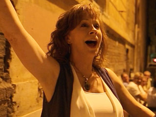 VIDEO: Reba McEntire Has a Major 'When In Rome...' Moment – and It's Fantastic!