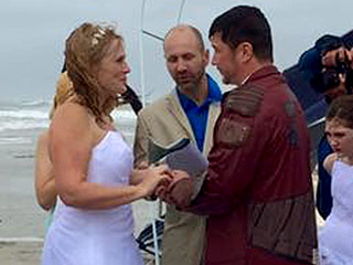 Couple Has Beach Wedding Despite Severe Storms, Wedding Party Joins Them in the Surf