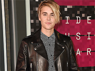 FROM EW: Justin Bieber on One Direction's Shared Album Release Date: 'It Was Strategy on Their Part'