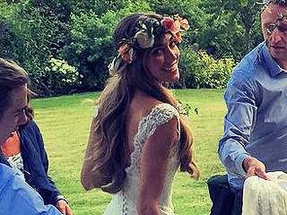 Guy Ritchie's Bride Jacqui Ainsley Stuns in a Low-Back Lace Wedding Gown (and a Flower Crown!)