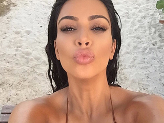 Kim Kardashian Proudly Displays Shocking Pregnancy Cleavage in Tiny Bikini