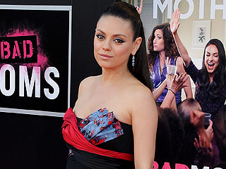 Mila Kunis Displays Her Baby Bump at Bad Moms Premiere
