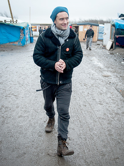 Jude Law Tours The Jungle Refugee Camp in Calais, France