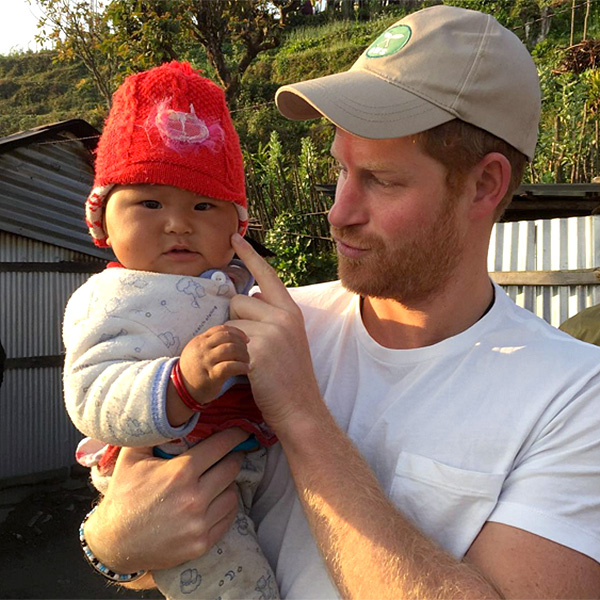 Prince Harry Holds Cute Baby In Nepal : People.com