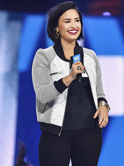 Demi Lovato Laughs Off a Tumble on Stage