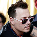 Johnny Depp Fits Hearing Aids at Charity Event in Portugal on Same Day Amber Heard Granted Restraining Order Against Actor