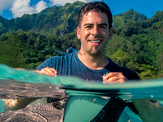 WATCH: Eli Roth Takes a PEOPLE Staffer Swimming with Baby Black Tip Sharks and Stingrays